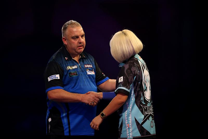 James Richardson shakes hands after winning against Mikuru Suzuki during day three of the William Hill World Championships at Alexandra Palace, London. (Photo by Steven Paston/PA Images via Getty Images)