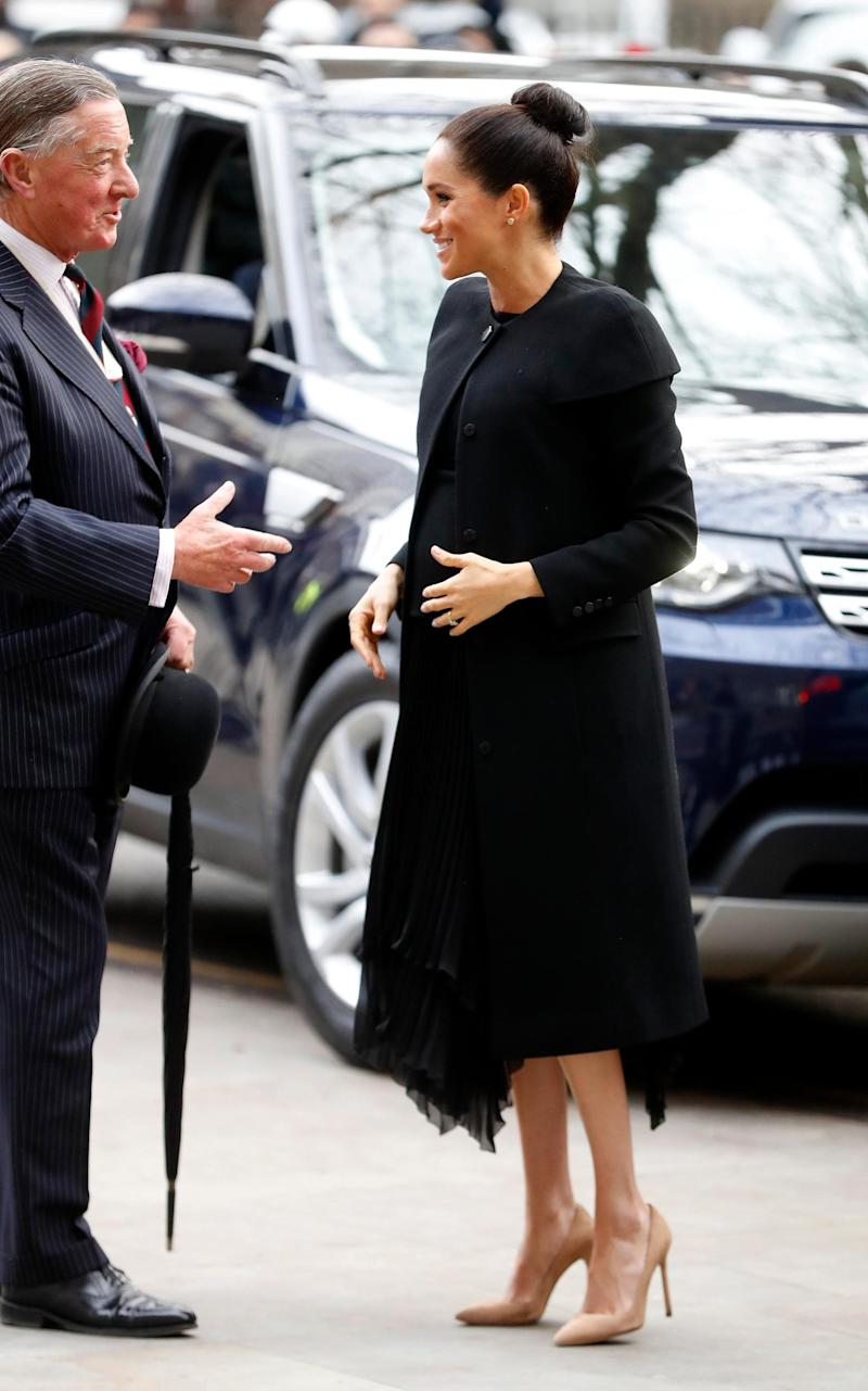 Meghan wearing heels while expecting her son Archie in 2019 - Getty