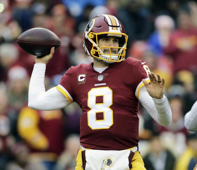 FILE - In this Dec. 17, 2017, file photo, Washington Redskins quarterback Kirk Cousins (8) throws the ball during an NFL football game against the Arizona Cardinals, in Landover, Md. Free agent quarterback Kirk Cousins is predictably the top priority on Minnesotas offseason shopping list. Cousins will visit with the Vikings on Wednesday, March 14, 2018, after the league year begins, his agent Mike McCartney said. (AP Photo/Mark Tenally, File)