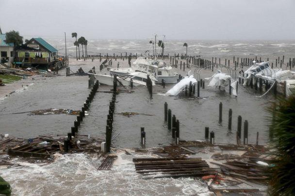 PHOTO: Storm Surge retreats from inland areas, foreground, where boats lay sunk and damaged at the Port St. Joe Marina, Oct. 10, 2018 in Port St. Joe, Fla. (Douglas R. Clifford/AP, FILE)