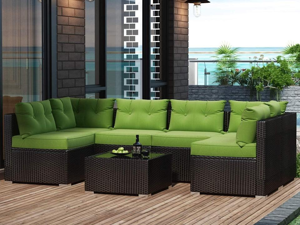 <p>We're green with envy over this comfortable <span>Amolife 7 Piece Patio PE Rattan Sofa Chair Set</span> ($560).</p>