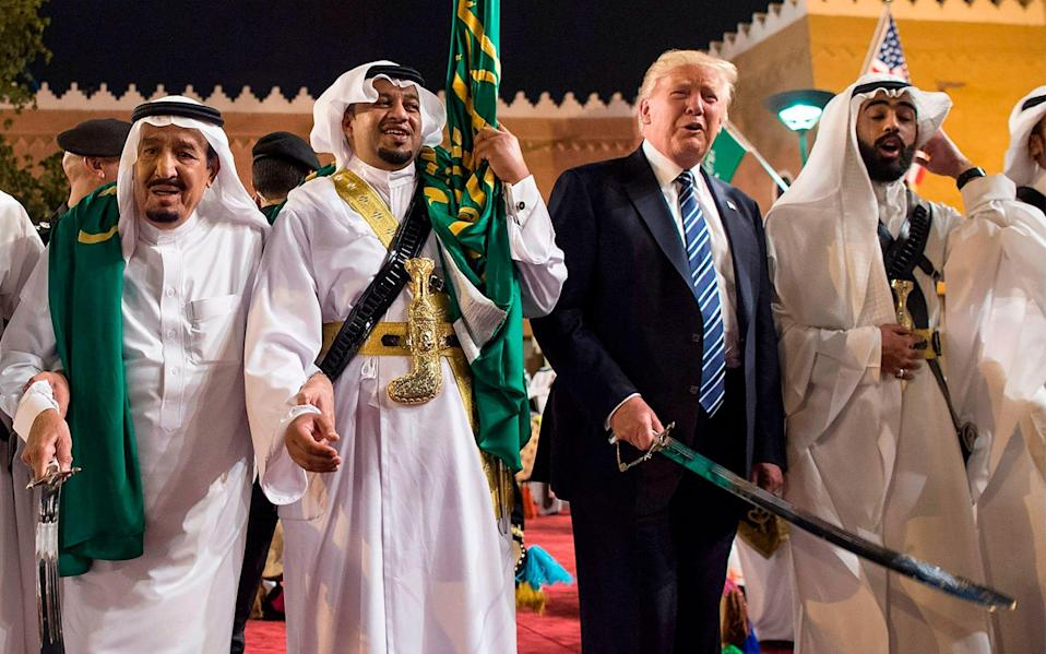 US President Donald Trump (2nd-R) and Saudi Arabia's King Salman bin Abdulaziz al-Saud (L) dancing with swords at a welcome ceremony ahead of a banquet at the Murabba Palace in Riyadh - AFP