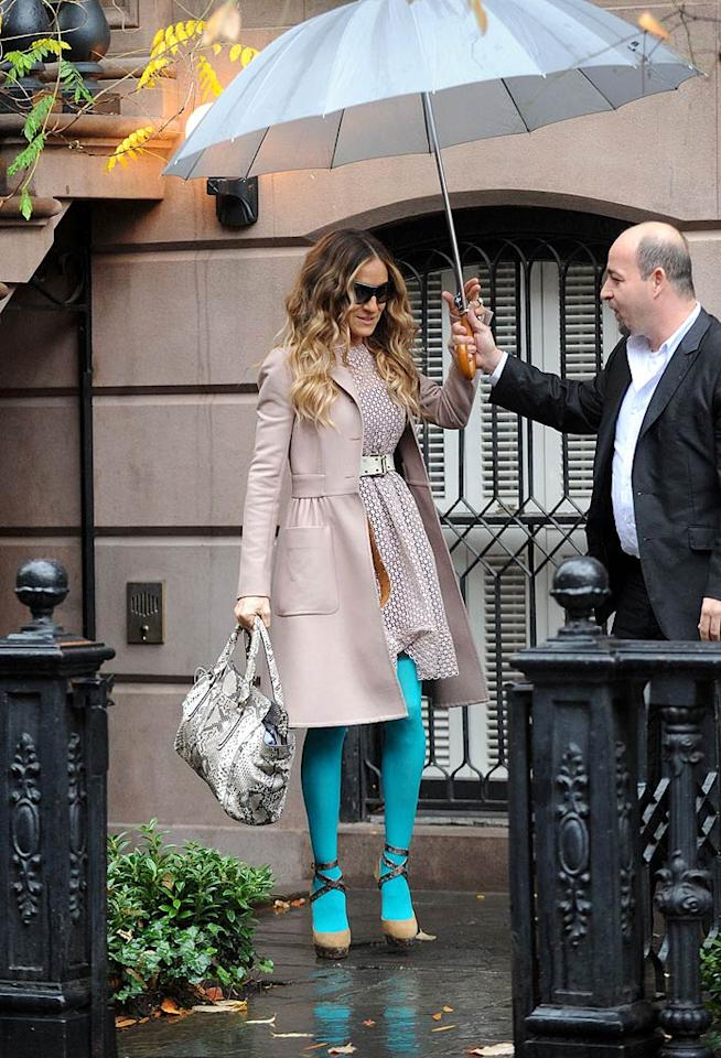 "We love this polka-dot Valentino dress on Sarah Jessica Parker (despite the fact that it's better suited for spring), but we cannot stand that the ""Sex and the City"" star paired the adorable piece (and a fab trench) with strappy Jimmy Choo sandals and aqua-colored tights from American Apparel. (12/6/2011)"