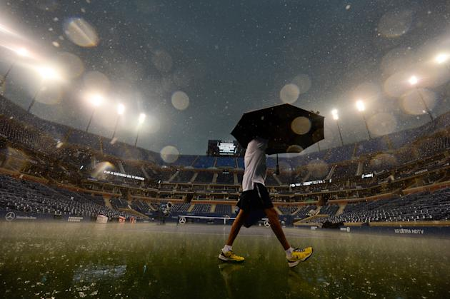 Aug 31, 2014; New York, NY, USA; Rain interrupts play during the Federer-Granollers match. (Robert Deutsch-USA TODAY Sports)
