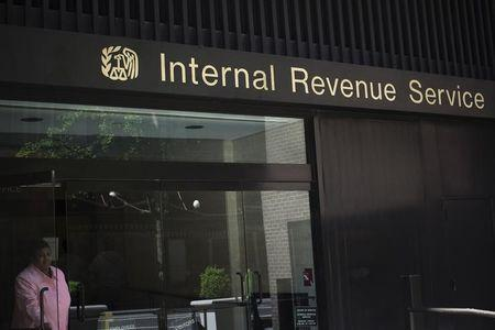 A woman walks out of the Internal Revenue Service building in New York