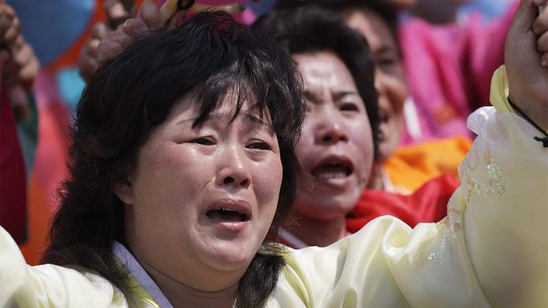 North Korean women cry as they march past leader Kim Jong-un. Source: AP
