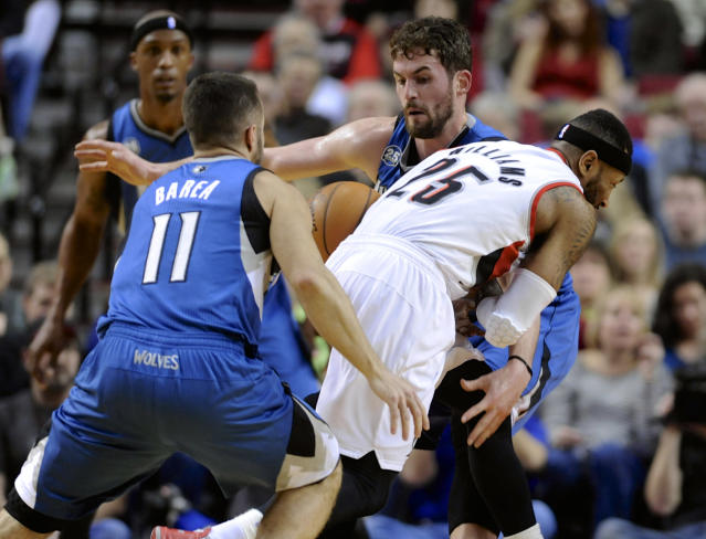 Minnesota Timberwolves' Kevin Love (42) strips the ball from Portland Trail Blazers' Mo Williams (25) during the first half of an NBA basketball game in Portland, Ore., Sunday Feb. 23, 2014. (AP Photo/Greg Wahl-Stephens)