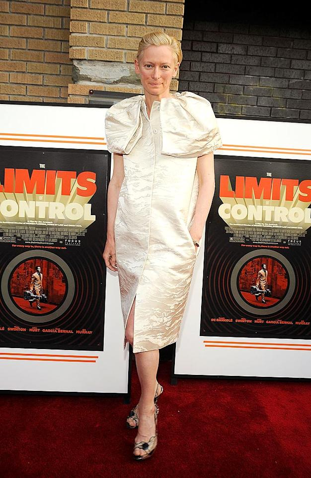 "Tilda Swinton strikes again at a screening of her new film, ""The Limits of Control,"" in an unflattering patterned frock adorned with frightening flaps at the shoulders. Gary Gershoff/<a href=""http://www.wireimage.com"" target=""new"">WireImage.com</a> - April 28, 2009"