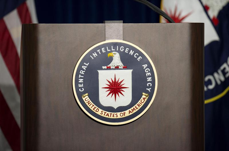 The lectern stands empty as reporters await the arrival CIA director John Brennan for a press conference at CIA headquarters in Langley, Virginia on December 11, 2014