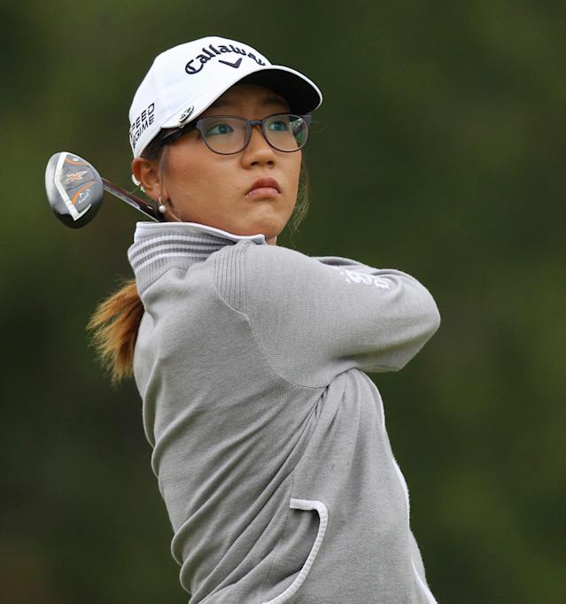 Lydia Ko watches her fairway shot on the third hole in the final round of the Manulife Financial LPGA Classic golf tournament Sunday, June 8, 2014, in Waterloo, Ontario. (AP Photo/The Canadian Press, Dave Chidley)