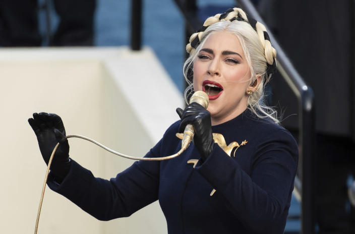 FILE - In this Jan. 20, 2021 file photo, Lady Gaga sings the national anthem during President-elect Joe Biden's inauguration at the U.S. Capitol in Washington. Los Angeles Police Department (LAPD) served several search and arrest warrants as a result of the investigation in the robbery of Lady Gaga's two stolen French bulldogs and shooting of her dog walker, Ryan Fischer, authorities announced Thursday, April 29, 2021, in Los Angeles. (AP Photo/Saul Loeb, Pool, File)