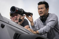 """This image released by Universal Pictures shows Director of photography Stephen F. Windon, left, with director Justin Lin on the set of """"F9."""" (Giles Keyte/Universal Pictures via AP)"""