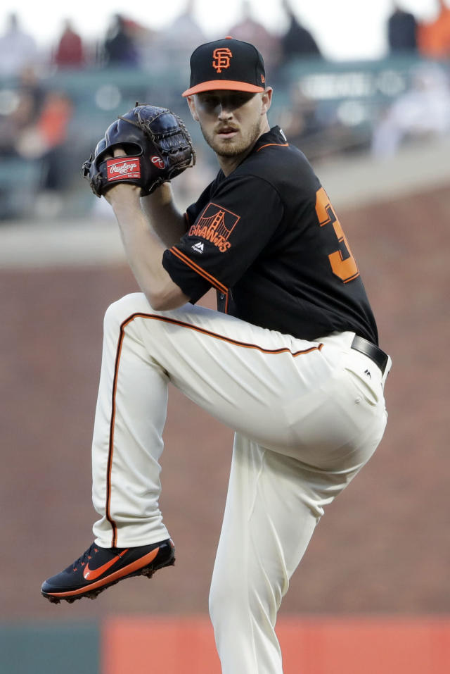 San Francisco Giants starting pitcher Chris Stratton throws to the Washington Nationals during the first inning of a baseball game Monday, April 23, 2018, in San Francisco. (AP Photo/Marcio Jose Sanchez)