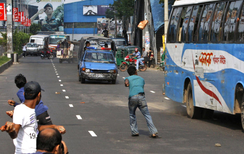 FILE - In this April 29, 2012 file photo, Bangladeshi opposition activists throw stones at vehicles during a nationwide general strike against the abduction of opposition politician Elias Ali in Dhaka, Bangladesh. The abduction of Ali and his driver as they returned home from meeting supporters at a hotel on April 17, 2012, has sparked one of Bangladesh's biggest crisis in years. The clashes have reignited hostilities between Prime Minister Sheikh Hasina and her archrival Khaleda Zia, who have alternated in power since a pro-democracy movement ousted the last military regime in 1990. (AP Photo/Pavel Rahman, File)