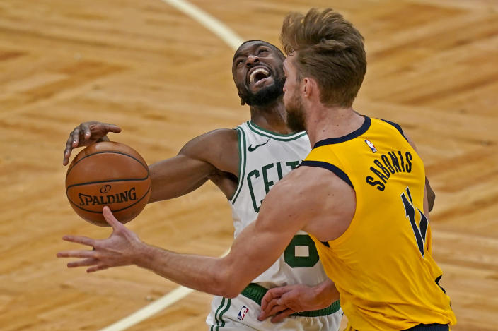 Boston Celtics guard Kemba Walker (8) reacts as he is fouled by Indiana Pacers forward Domantas Sabonis (11) in the fourth quarter of an NBA basketball game, Friday, Feb. 26, 2021, in Boston. (AP Photo/Elise Amendola)