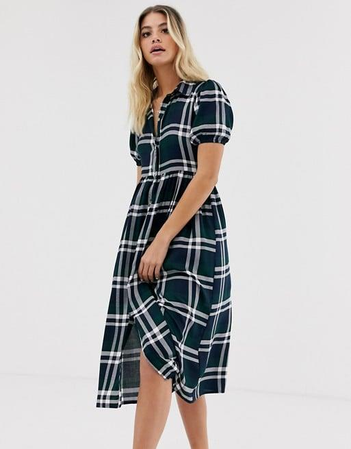 """<p>Add some print to your closet with this <a href=""""https://www.popsugar.com/buy/Wednesday-Girl-Midi-Shirt-Dress-480696?p_name=Wednesday%27s%20Girl%20Midi%20Shirt%20Dress&retailer=us.asos.com&pid=480696&price=38&evar1=fab%3Aus&evar9=45278025&evar98=https%3A%2F%2Fwww.popsugar.com%2Ffashion%2Fphoto-gallery%2F45278025%2Fimage%2F46553699%2FWednesday-Girl-Midi-Shirt-Dress&list1=shopping%2Cfall%20fashion%2Cdresses%2Cfall%2Caffordable%20shopping&prop13=mobile&pdata=1"""" rel=""""nofollow"""" data-shoppable-link=""""1"""" target=""""_blank"""" class=""""ga-track"""" data-ga-category=""""Related"""" data-ga-label=""""https://us.asos.com/wednesdays-girl/wednesdays-girl-midi-shirt-dress-in-check/prd/12660168?clr=navy-white-check&amp;colourWayId=16466807&amp;SearchQuery=&amp;cid=2623"""" data-ga-action=""""In-Line Links"""">Wednesday's Girl Midi Shirt Dress</a> ($38).</p>"""