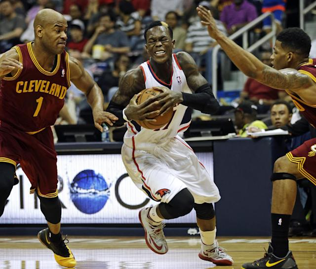 Atlanta Hawks' Dennis Schroder, center, drives to the hoop between the defense of Cleveland Cavaliers' Jarrett Jack, left, and Alonzo Gee in the second quarter of an NBA basketball game, Friday, April 4, 2014, in Atlanta. The Hawks beat the Cavaliers 117-98. (AP Photo/David Goldman)