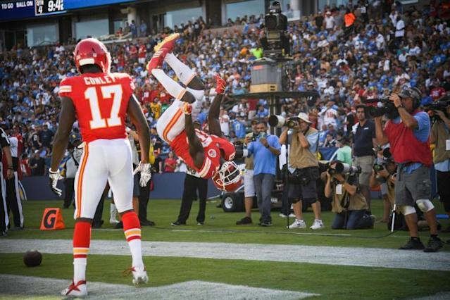 Tyreek Hill shows off his gymnastic moves after scoring one of his three touchdowns on Sunday. (Getty Images)