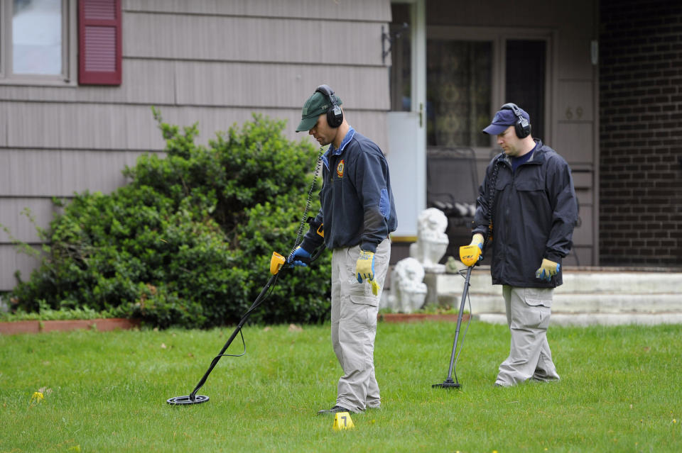 FILE - In this May 10, 2012, file photo, law enforcement agents search the yard at the home of reputed Connecticut mobster Robert Gentile in Manchester, Conn. The chief investigator for a Boston museum still working to recover $500 million worth of art stolen in 1990 said Thursday, Sept. 23, 2021, that he was hoping for new leads to emerge in the case following the recent death of Gentile. (AP Photo/Jessica Hill, File)