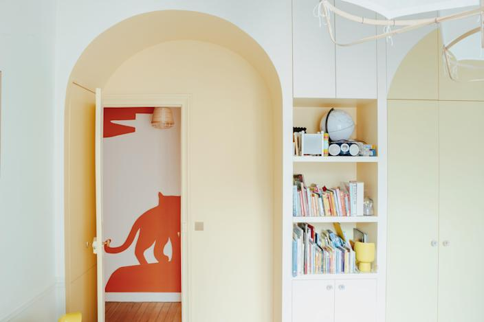 In the kids' room, the corridor cutouts peek through the doorway.