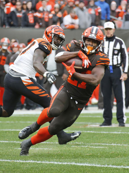 Cleveland Browns running back Kareem Hunt, right, scores a 3-yard touchdown during the second half of an NFL football game against the Cincinnati Bengals, Sunday, Dec. 8, 2019, in Cleveland. The Browns won 27-19. (AP Photo/Ron Schwane)