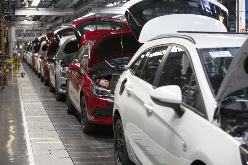 A line of cars on a car assembly line at the Vauxhall car factory. Photo: Getty