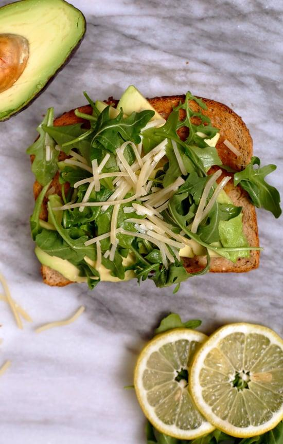 "<p><strong>Get the recipe:</strong> <a href=""https://www.popsugar.com/food/Avocado-Toast-Recipes-Video-36701287"" class=""ga-track"" data-ga-category=""Related"" data-ga-label=""http://www.popsugar.com/food/Avocado-Toast-Recipes-Video-36701287"" data-ga-action=""In-Line Links"">avocado toast with arugula, parmesan, and lemon juice</a>.</p>"