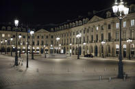 Vendome square is empty during curfew in Paris, Saturday, Oct. 17, 2020. French restaurants, cinemas and theaters are trying to figure out how to survive a new curfew aimed at stemming the flow of record new coronavirus infections. The monthlong curfew came into effect Friday at midnight, and France is deploying 12,000 extra police to enforce it. (AP Photo/Lewis Joly)