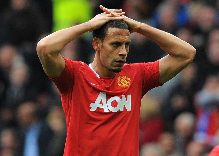 United defender Rio Ferdinand looks on ruefully after his side surrendered a 4-2 lead over Everton on April 22, 2012