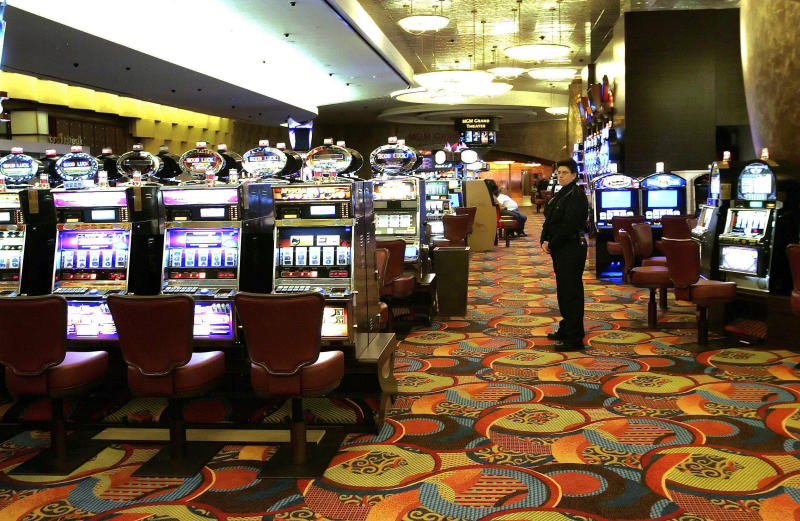FILE - In this May 13, 2008 file photo, one of the slot machine rooms at the new MGM Grand Hotel stands ready for the start of business at the Foxwoods Resort Casino in Mashantucket, Conn. The spread of casino gambling is reaping billions of dollars for industry and government coffers, but also is creating more compulsive gamblers. Advocates for treatment services point to gaps between the amount of money states receive and what they spend on compulsive gambling. In 2012, Connecticut's gambling industry generated almost $659 million in state revenue, while problem gambling services received $1.9 million. (AP Photo/Bob Child, File)