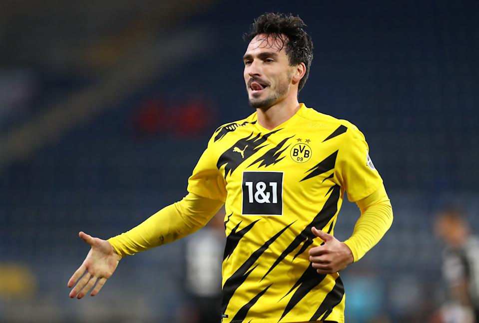 BIELEFELD, GERMANY - OCTOBER 31: Mats Hummels of Borussia Dortmund  celebrates after he scores his team's second goal  during the Bundesliga match between DSC Arminia Bielefeld and Borussia Dortmund at Schueco Arena on October 31, 2020 in Bielefeld, Germany. Sporting stadiums around Germany remain under strict restrictions due to the Coronavirus Pandemic as Government social distancing laws prohibit fans inside venues resulting in games being played behind closed doors. (Photo by Martin Rose/Getty Images)
