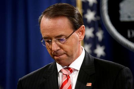 FILE PHOTO: Deputy U.S. Attorney General Rod Rosenstein pauses while announcing grand jury indictments of 12 Russian intelligence officers in special counsel Robert Mueller's Russia investigation, during a news conference at the Justice Department in Washington, U.S., July 13, 2018. REUTERS/Leah Millis/File Photo