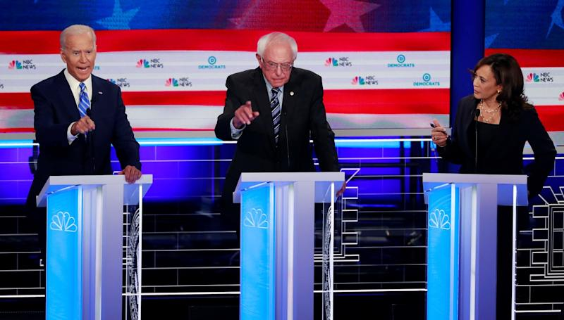 From left, Joe Biden, Bernie Sanders and Kamala Harris go at it during a contentious June 2019 presidential debate in Miami.