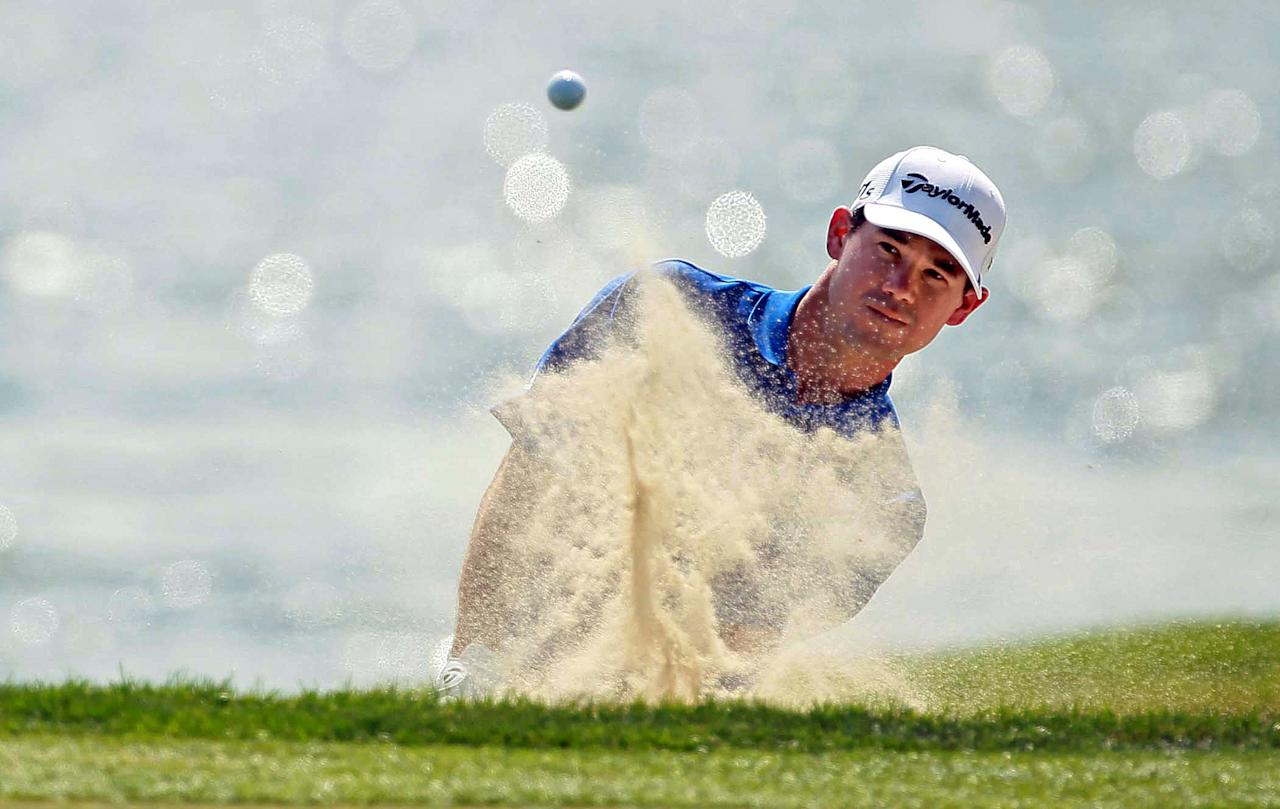 Brian Harman hits out of the bunker on the 18th hole in the second round of the Honda Classic golf tournament in Palm Beach Gardens, Fla., Friday, March 2, 2012. Harman shot 9-under-par for the round and is 6-under-par after two rounds. (AP Photo/The Palm Beach Post, Allen Eyestone) MAGS OUT; TV OUT; NO SALES