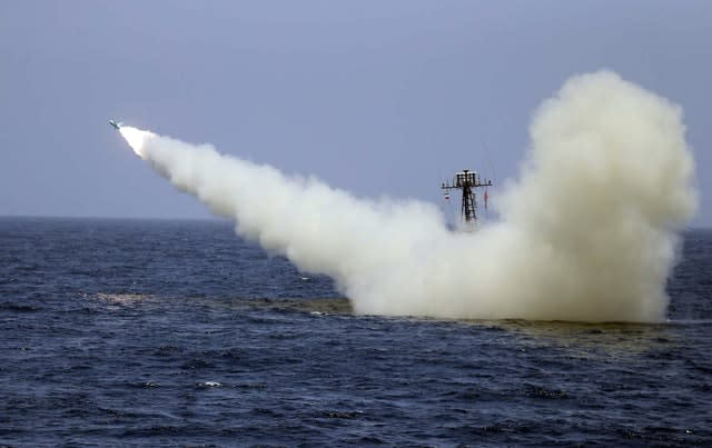 A warship launches a missile during an Iranian naval exercise