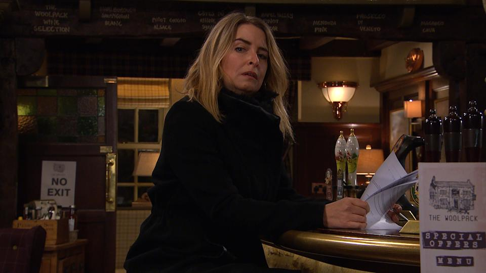 FROM ITV  STRICT EMBARGO  Print media - No Use Before Tuesday 16th February 2021 Online Media - No Use Before 0700hrs  Tuesday 16th February 2021  Emmerdale - Ep 897677  Tuesday 23rd February 2021  Charity Dingle [EMMA ATKINS] is still being shunned by all. As she signs away the contract for her share of the pub.   Picture contact David.crook@itv.com   This photograph is (C) ITV Plc and can only be reproduced for editorial purposes directly in connection with the programme or event mentioned above, or ITV plc. Once made available by ITV plc Picture Desk, this photograph can be reproduced once only up until the transmission [TX] date and no reproduction fee will be charged. Any subsequent usage may incur a fee. This photograph must not be manipulated [excluding basic cropping] in a manner which alters the visual appearance of the person photographed deemed detrimental or inappropriate by ITV plc Picture Desk. This photograph must not be syndicated to any other company, publication or website, or permanently archived, without the express written permission of ITV Picture Desk. Full Terms and conditions are available on  www.itv.com/presscentre/itvpictures/terms