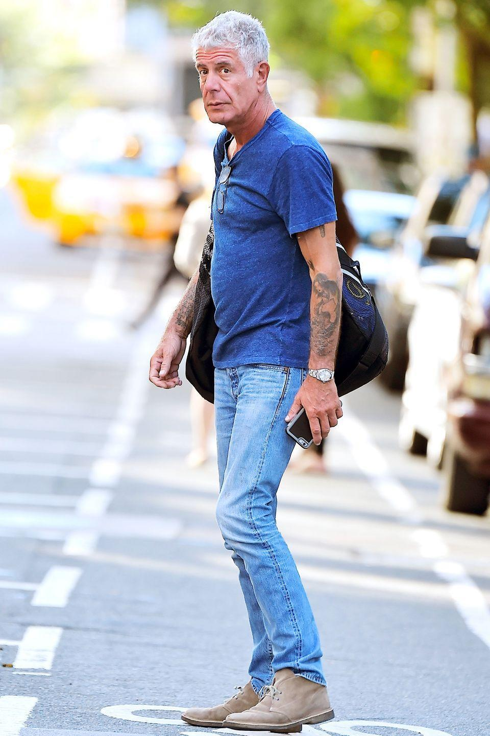 <p>Bourdain attempts to hail a cab in New York on September 22, 2016.</p>