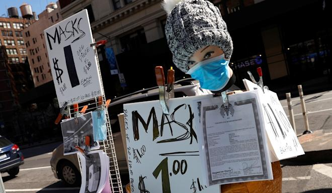 Surgical masks on sale at a Manhattan street corner in March. Photo: Reuters