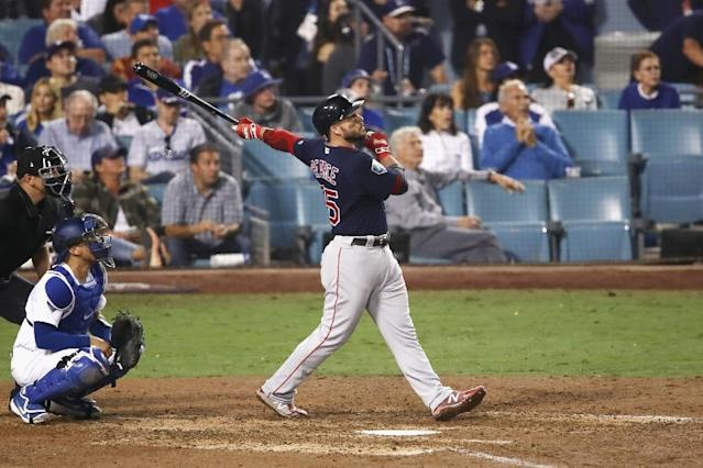 Boston first baseman Steve Pearce unleashes a home run as the Red Sox stun the Los Angeles Dodgers with a come-from-behind victory to move to the brink of the World Series (AFP Photo/EZRA SHAW)
