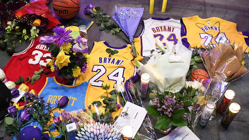 Jerseys, flowers and candles, pictured here at a makeshift memorial for Kobe Bryant in front of Staples Centre.
