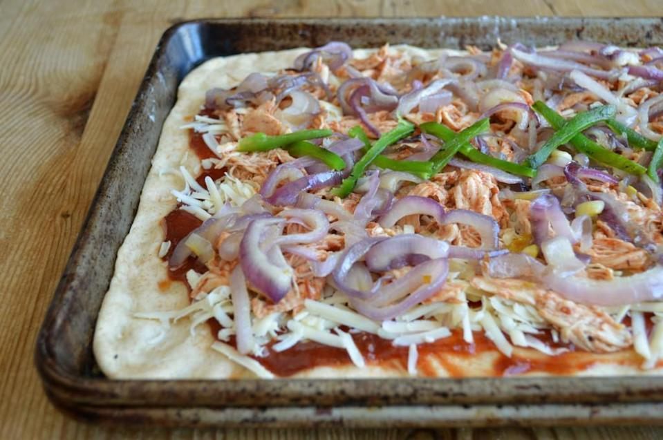 "<p>Homemade <a href=""https://www.thedailymeal.com/eat/favorite-pizza-chains?referrer=yahoo&category=beauty_food&include_utm=1&utm_medium=referral&utm_source=yahoo&utm_campaign=feed"" rel=""nofollow noopener"" target=""_blank"" data-ylk=""slk:pizza"" class=""link rapid-noclick-resp"">pizza</a> dough can be time-consuming, but once it's risen and ready to bake, it's well worth the wait. But for something like this BBQ Chicken Flatbread, you could always use pre-made dough and take a ""semi-homemade"" approach. For this recipe, toss cooked and shredded chicken in your favorite barbecue sauce, saute some onions and peppers, spread the sauce on a rectangular rolled-out dough, and start topping. Flatbreads are incredibly versatile, and you can make endless variations. </p> <p><a href=""https://www.thedailymeal.com/best-recipes/bbq-chicken-flatbread-homemade-recipe?referrer=yahoo&category=beauty_food&include_utm=1&utm_medium=referral&utm_source=yahoo&utm_campaign=feed"" rel=""nofollow noopener"" target=""_blank"" data-ylk=""slk:For the BBQ Chicken Flatbread recipe, click here"" class=""link rapid-noclick-resp"">For the BBQ Chicken Flatbread recipe, click here</a>.</p>"