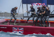 In this photo provided by SailGP, the Britain SailGP Team presented by INEOS, helmed by Sir Ben Ainslie, celebrate their win in the final race on race Day 2 of the Bermuda SailGP event in Hamilton, Bermuda, Sunday, April 25, 2021. (Bob Martin/SailGP via AP)