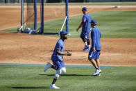 Chicago Cubs right fielder Jason Heyward warms up during baseball practice at Wrigley Field on Friday, July 3, 2020 in Chicago. (AP Photo/Kamil Krzaczynski)