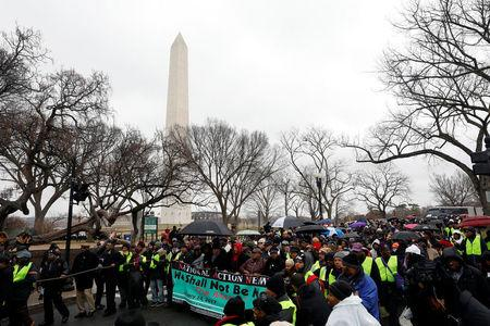 """Activists march during the National Action Network's """"We Shall Not Be Moved"""" march in Washington, DC, U.S., January 14, 2017. REUTERS/Aaron P. Bernstein"""