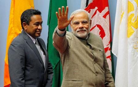 FILE PHOTO: Modi waves as Yameen looks on during the closing session of 18th SAARC summit in Kathmandu