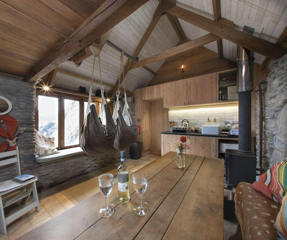"""<p>You're going to want to pinch yourself after reading about this coastal spot because it almost sounds too good to be true. The beach hut is located down a very steep cliff path following a 15 minute walk from a parking spot which should be enough to tell you that you'll be completely secluded in this paradise spot. </p><p>Perched above jagged rocks, this hut has its own private beach, wood fire hot tub, hammock chairs and BBQ. With an organic farm shop located 10 minutes away and a local hamper of cream tea available to preorder from the hosts before your arrival, we can't imagine a better place to eat, sleep, explore rock pools and swim in the sea. It's so good, in fact, we're regretting letting you know about it. </p><p>We'll race you to book it! </p><p><strong>Cabin for 2 from £325 per night</strong></p><p><a class=""""link rapid-noclick-resp"""" href=""""https://www.canopyandstars.co.uk/britain/england/devon/carswell-farm/carswell-beach-hut"""" rel=""""nofollow noopener"""" target=""""_blank"""" data-ylk=""""slk:BOOK ONLINE"""">BOOK ONLINE</a></p>"""