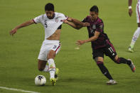 United States' Mauricio Pineda and Mexico's Roberto Alvarado fight for the ball during a Concacaf Men's Olympic Qualifying championship soccer match in Guadalajara, Mexico, Wednesday, March 24, 2021. (AP Photo/Fernando Llano)