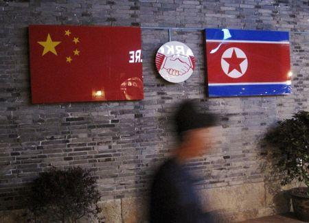 Flags of China and North Korea are seen outside the closed Ryugyong Korean Restaurant in Ningbo, Zhejiang province, China, April 12, 2016. REUTERS/Joseph Campbell - GF10000380139