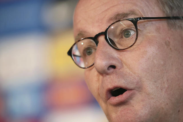 Austrian Herbert Huebel, chairman of the FIFA monitoring committee for the Hellenic Football Federation answers a question during a press conference in Athens, Wednesday, March 14, 2018. FIFA has sent a delegation to Greece to discuss the country's soccer crisis, after the government indefinitely suspended top league matches. The suspension followed a pitch invasion by the gun-toting owner of PAOK Thessaloniki Sunday after a late goal for his team was disallowed by the referee. (AP Photo/Petros Giannakouris)