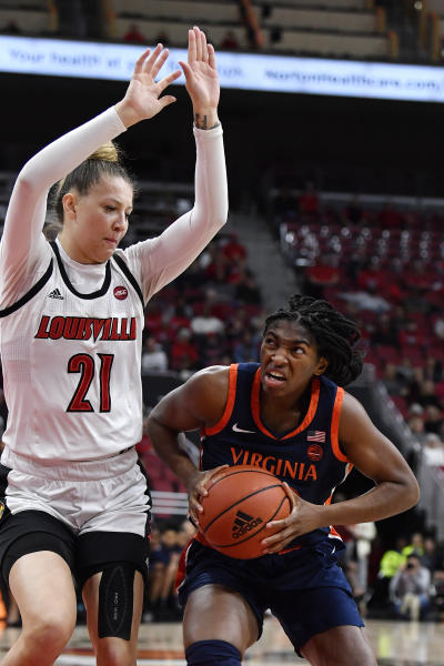 Virginia forward Meg Jefferson (12) tries to get by Louisville forward Kylee Shook (21) during the first half of an NCAA college basketball game in Louisville, Ky., Thursday, Jan. 23, 2020. (AP Photo/Timothy D. Easley)